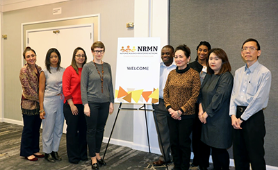 NRMN staff stand and pose for a photo